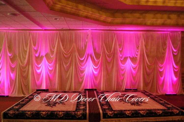 Ivory back drop with hot pink LED up lights